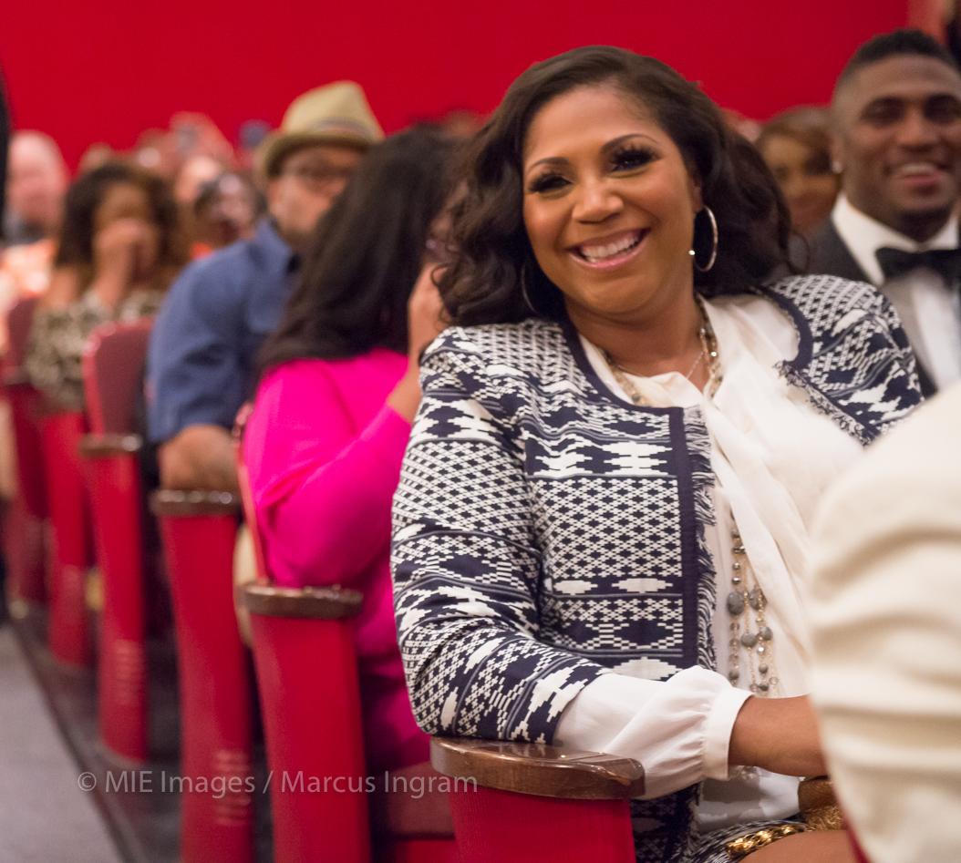 Trina Braxton smiles in audience